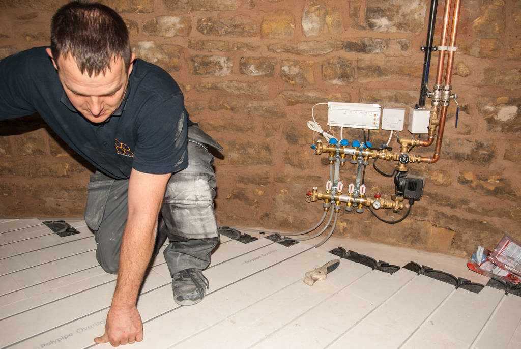 Bumford's engineer Phil installing underfloor heating