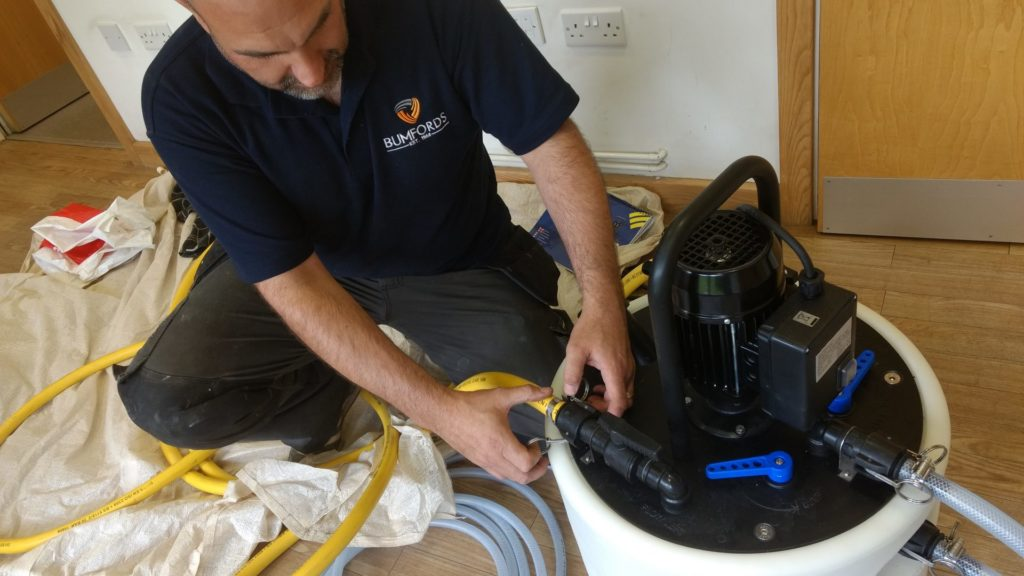 Bumfords engineer Craig Powerflushing in an office in Barnsley.